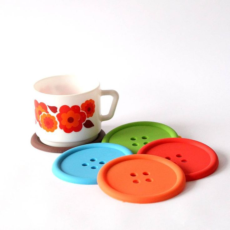 Coasters shaped like a button.Perfect for protecting your surfaces from unsightly ring marks - whether it's your craft table, desk or coffee table! Button coasters appeal to those who sew, craft or people who just like buttons. And playing with them. And collecting them. Made from brightly coloured silicone in a choice of different colours. Suitable for use with both hot and cold drinks.Silicone9cm diameter x 0.5cm depth