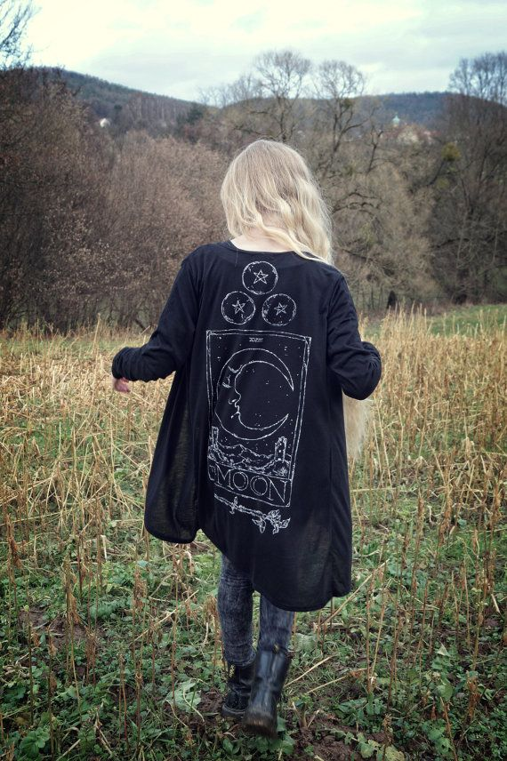 This comfy black cardigan features a big handpainted illustration of the Tarot card The Moon along with three pentacle coins and a magic wand.