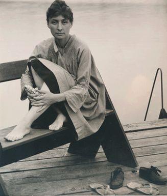 Alfred Stieglitz (1864 - 1946), Georgia O'Keeffe [Seated on Bench, Feet Bare], 1930s. Gelatin silver print, 8 ¾ x 7 3/8 inches. Georgia O'Keeffe Museum. 2013.04.056