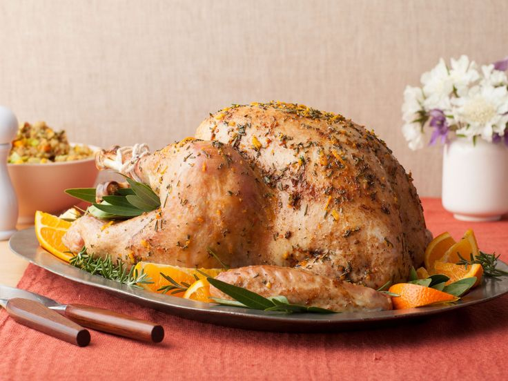 The Pioneer Woman's Roasted Thanksgiving Turkey : Ree takes her brined bird out of the oven halfway through its cooking time to spread butter on it before it finishes cooking. This ensures that it ends up with that deep, golden-brown color.