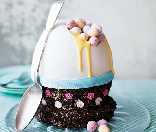 really impressive homemade Easter egg cake recipe decorated to look like a giant egg with Cadbury mini eggs and custard yolk
