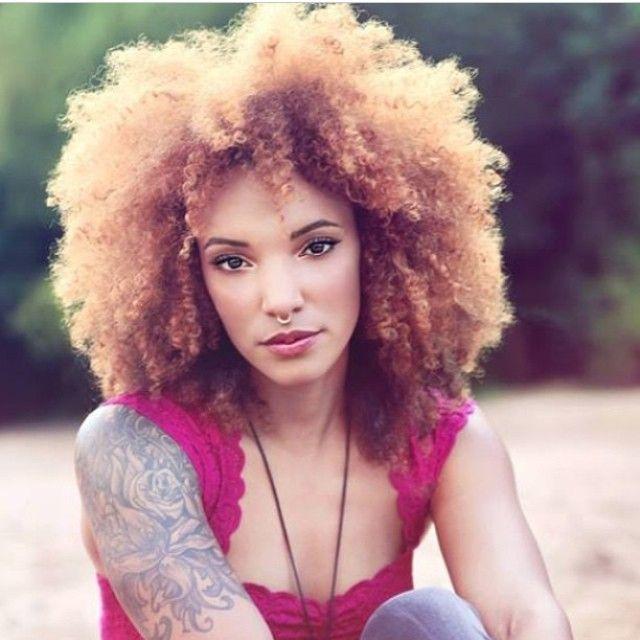 Natural Hair. Skin tone and tats...she is beautiful.