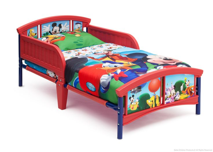 Make his bedroom magical with this Mickey Mouse Plastic Toddler Bed from Delta Children! Featuring adorable graphics of Mickey and friends, this sturdy bed is outfitted with two side rails, so you can