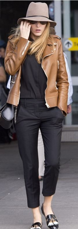 Brown leather jacket with black trousers and black tee