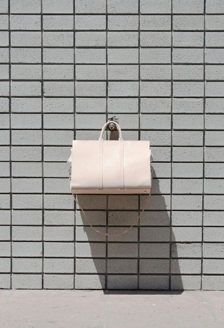idea for kitchen backsplash, pale blue tiles with grey grout?