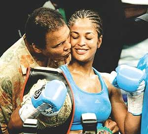 Laila Ali, Awesome female fighter with a boxing record to show it, and of course making her daddy proud, Ali! :)