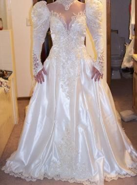 During the 90's, it was not unusual to find a bride power dressing by wearing large shoulder pads in her wedding dress.