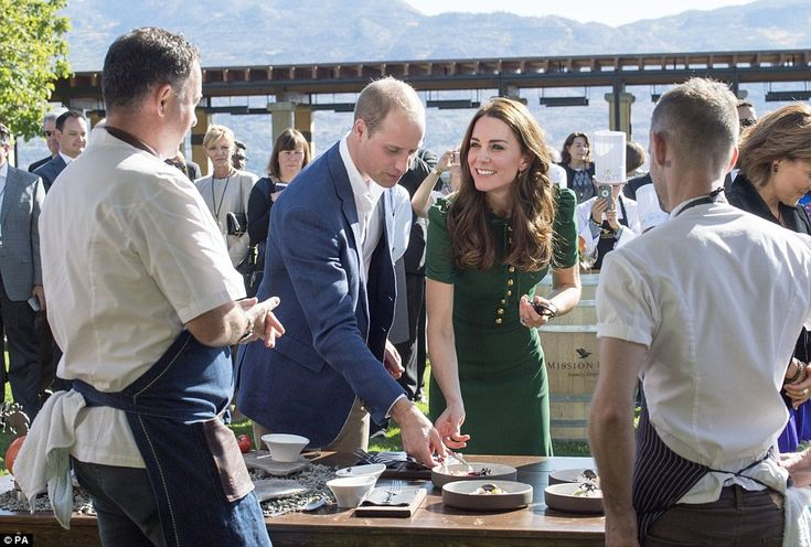 Smiling at one of the chefs presenting at the festival, the duchess reaches down to try another morsel of food