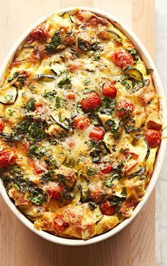 Tomato-Zucchini Strata: Swiss cheese, plump tomatoes, tender zucchini and herbs flavor a rich brunch casserole. Bonus: You can make it a day ahead and bake it in the morning. Recipe: http://www.midwestliving.com/recipe/tomato-zucchini-strata/