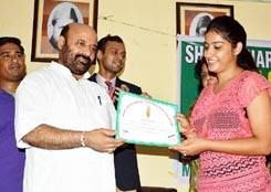 Minister for Health & Medical Education Bali Bhagat presenting certificate .