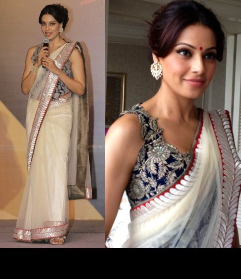 Bipasha Basu wearing a white Anamika Khanna sari with an embroidered blue blouse with Amrapali jewelry.