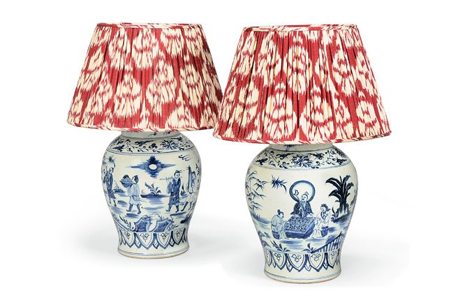 Red and white patterned lampshades on blue and white porcelain lamp bases - UK's top tastemakers, Robert Kime and Piers von Westenholz