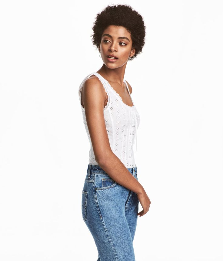Check this out! Sleeveless top in airy, woven fabric with eyelet embroidery. Lace-covered edges, decorative lacing at front, and boning at front and back. Concealed zip at back. - Visit hm.com to see more.