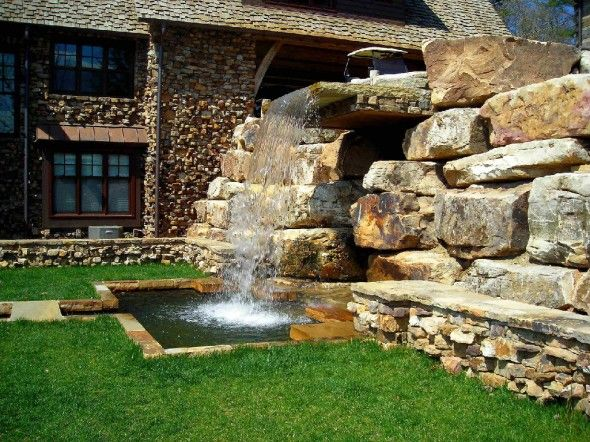 Amazing Waterfall Fountain As The Focal Point Of The Front Yard.