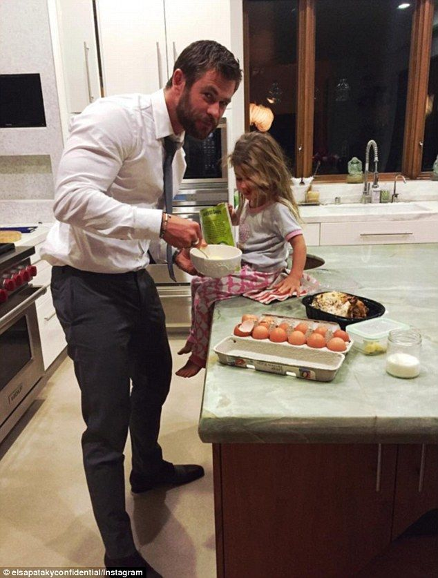 Doting father: Chris Hemsworth's actress wife Elsa Pataky shared a tender snap of the 32-y...
