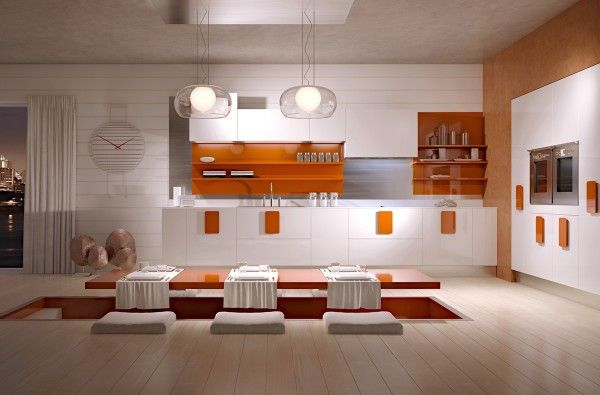 The reddish orange accents in this kitchen, and the creative sunken dining table, give the kitchen a really retro feel.