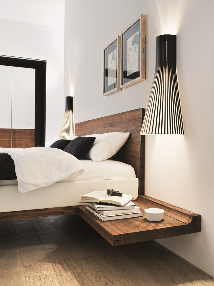 Secto 4230 wall lights by Secto Design framing a beautiful wooden bed by Austrian brand Team7.