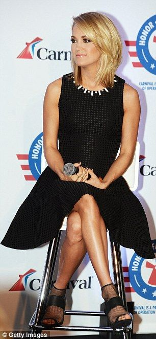 Werk! Stylist Trish Townsend dressed the 32-year-old country crooner in a sleeveless, ladlylike LBD and cute mesh booties