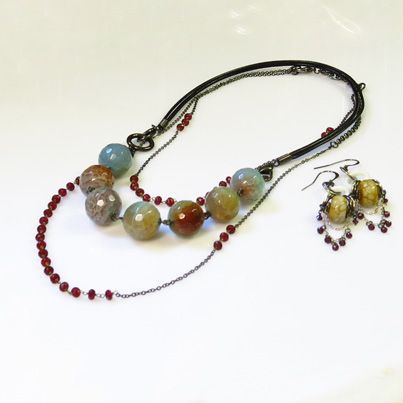 Snakeskin agate bead necklace  on detachable leather strap, with separate necklace of cherry agate faceted beads. Tasseled earrings of the same. www.carolinetrask.com