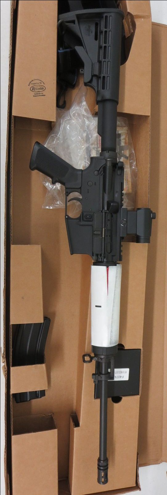 Used Bushmaster AR-15 5.56/.223 w/ red dot and box $575 - http://www.gungrove.com/used-bushmaster-ar-15-5-56-223-w-red-dot-and-box-575/