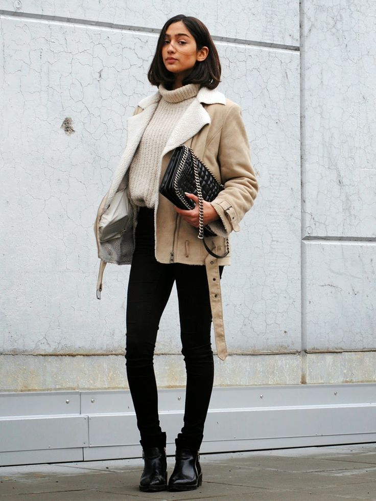 A nude shearling jacket and black skinny jeans will showcase your sartorial self. Black leather chelsea boots will add a new dimension to an otherwise classic look.  Shop this look for $160:  http://lookastic.com/women/looks/shearling-jacket-turtleneck-skinny-jeans-chelsea-boots-crossbody-bag/6787  — Beige Shearling Jacket  — Beige Knit Turtleneck  — Black Skinny Jeans  — Black Leather Chelsea Boots  — Black Quilted Leather Crossbody Bag