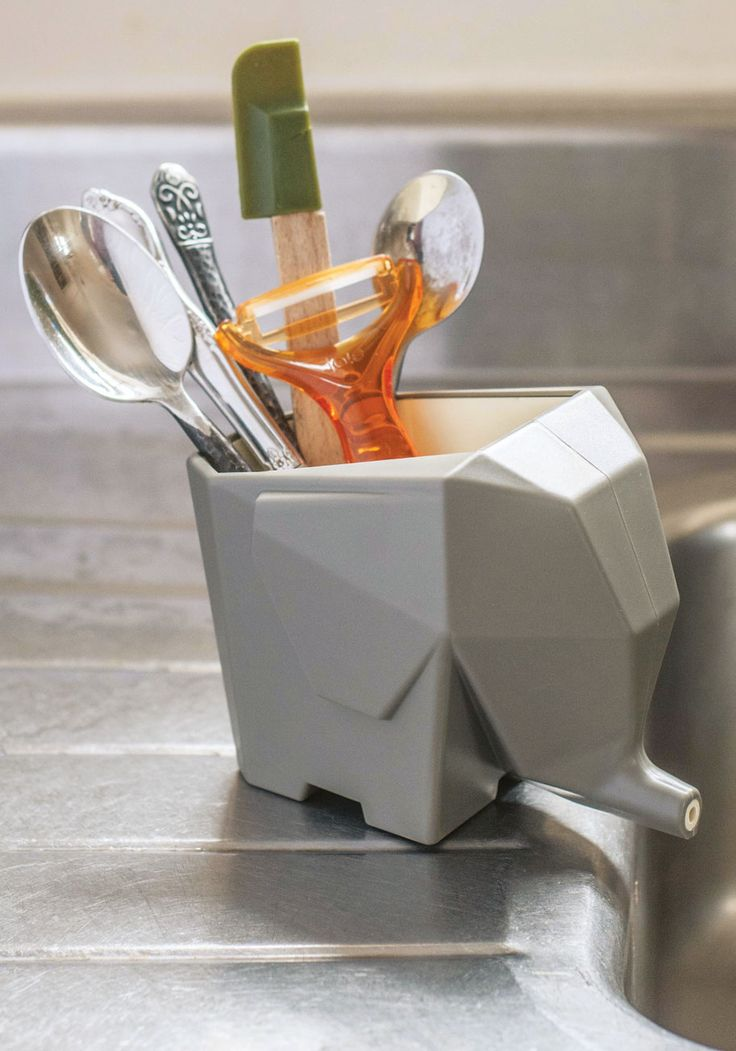 Shaped like a faceted grey elephant, this cutlery cup or sink-side storage unit drains from out of its trunk, helping to keep your countertop spotless and super-fun!