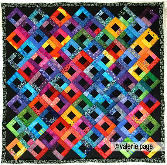 Bright Scraps on Black Quilt - by Valerie Page - Machine pieced and hand quilted.
