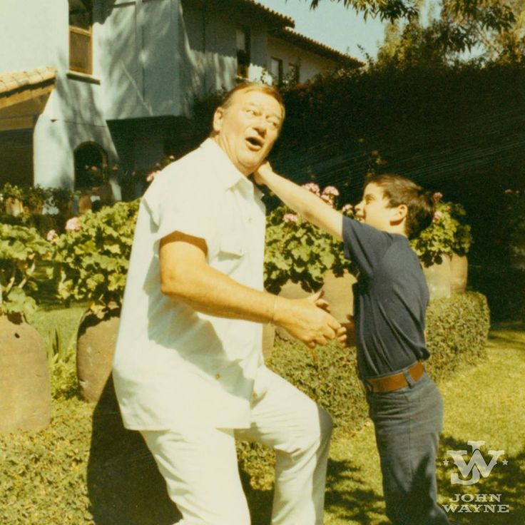 John Wayne giving youngest son, Ethan boxing lessons.