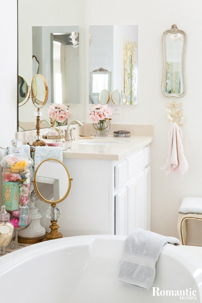 this tract home bathroom gets a vintage makeover with a farmhouse style bathtub and vintage bathroom