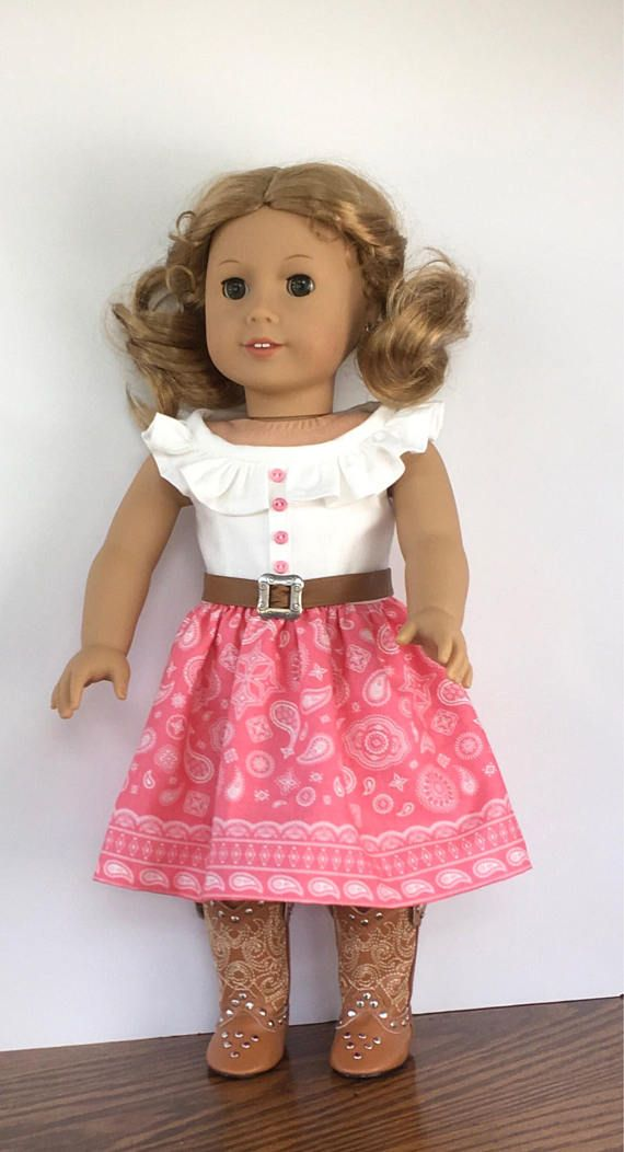 A sweet dress for your country diva. This dress is made from cotton fabric. The bodice is an off white color and is fully lined. There is a gathered ruffle at the neckline. Four coral pink buttons are hand sewn to the front. The skirt is gathered and is a coral pink color with a