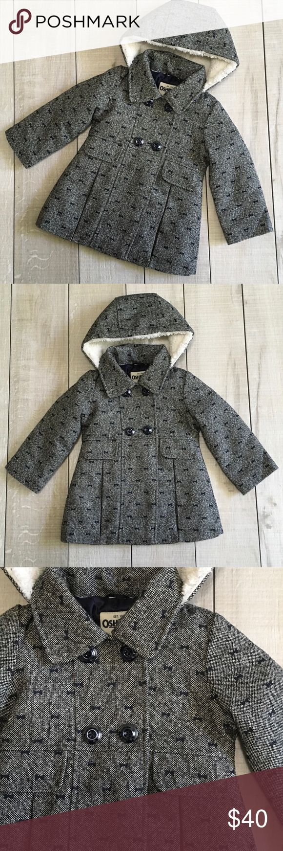 NEW LISTING - Gorgeous Navy Metallic Winter Coat Size 2T. OshKosh B'gosh winter dress coat. Navy and white with silver metallic thread. This coat is gorgeous and warm! Excellent used condition. Tried on indoors. Still has the removable stitches across bottom pleats as shown in photos. Real front pockets. Name tag on inside. Smoke free home. OshKosh B'gosh Jackets & Coats Pea Coats