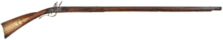 A flintlock long rifle crafted by Leonard Reedy of Womelsdorf, Pennsylvania, 18th century.