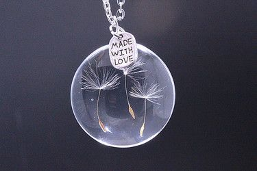 This necklace is made of solid glass.The real dandelion was so beautiful.