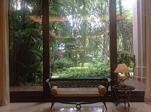 Lobby with huge windows showing a magnificently clear view of the lush garden