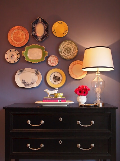 A wall collage of plates