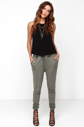 For days on the go, (or on the couch!) the Black Swan Cameo Olive Green Jogger Pants are the key to staying chic and cozy all day long! These soft and lightweight rayon knit jogger pants have an elastic drawstring waistband that tops the rounded front pockets, and slouchy pant legs that taper to elastic cuffs. Unlined and slightly sheer. 100% Rayon. Hand Wash Cold. Imported.