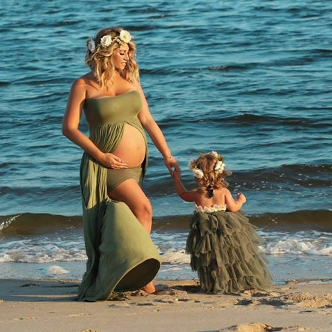 Check out this item in my Etsy shop https://www.etsy.com/listing/240781408/olive-green-maternity-gown-ready-to-ship