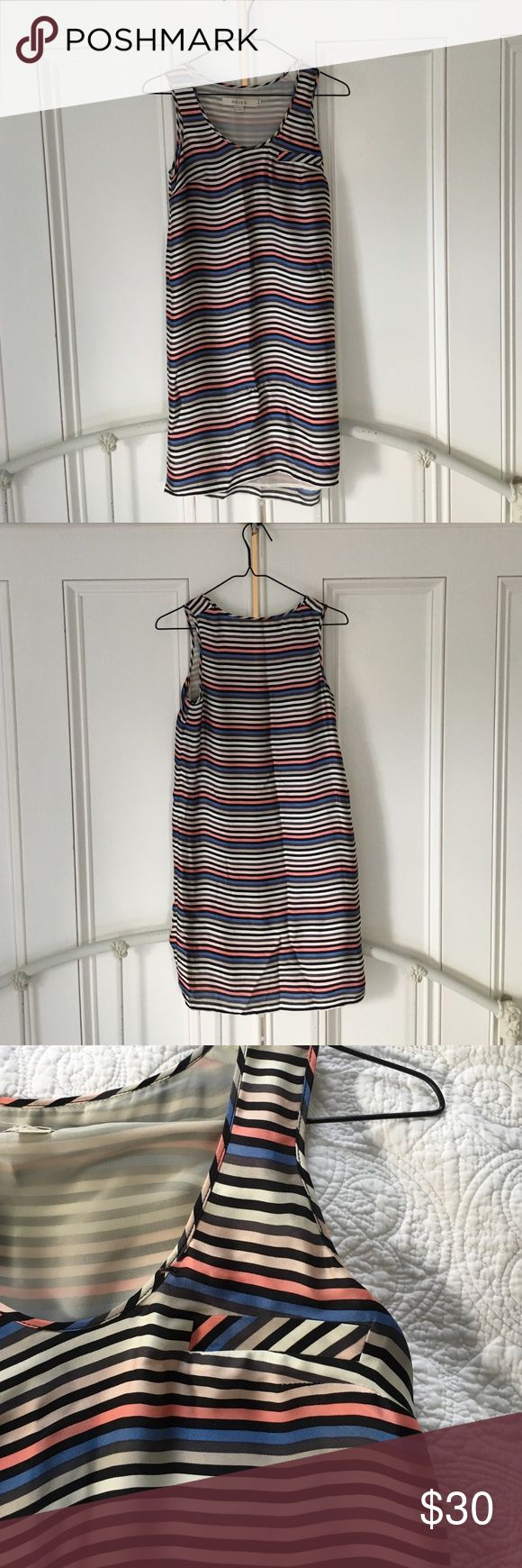 Striped silk Reiss dress Reiss striped silk dress. Fully lined, faux chest pocket on one side, very tiny pull at the bottom of the front (very hard to notice- see last photo). Hits a few inches above the knee. Perfect to layer with tights, boots, and a cardigan this winter. Reiss Dresses Midi