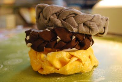 Fabric Bracelet - I would add a yoyo or a crochet flower or a rolled rose...  the list goes on and on!