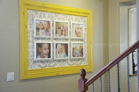 Large frame, pattern behind, framed photos inside.