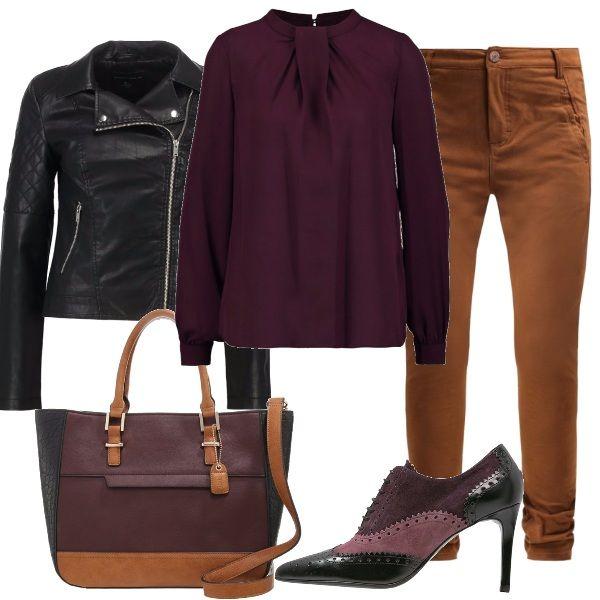 Questo outfit, basato su colori autunnali e caldi, è adatto per il lavoro, infatti mantiene la sua linea austera ed elegante. I pantaloni color cognac sono abbinati ad una camicetta viola scuro, il tutto completato da un giubbotto di pelle nero. Per quanto riguarda gli accessori, l'abbinamento è completo: Le scarpe francesine riprendono il colore della camicetta e il giubbotto, mentre la borsa, di colore viola, ha dettagli in nero e cognac.