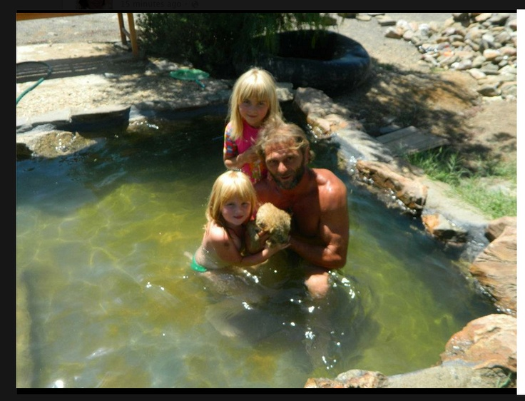 Boemsie, Katrol and me with Ella, this cub like to swim. — in Jansenville, Eastern Cape, South Africa.    http://www.facebook.com/DigitalAgeJournalist