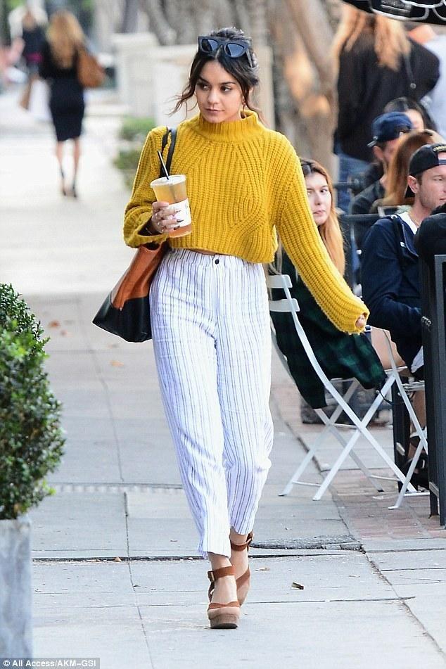 Vanessa Hudgens wearing Quay Eyeware Kitti Sunglasses, Danielle Nicole Savannah Tote in Cognac, Free People Walk This Way Clogs and Again Collection Alaska Mustard Crop Sweater