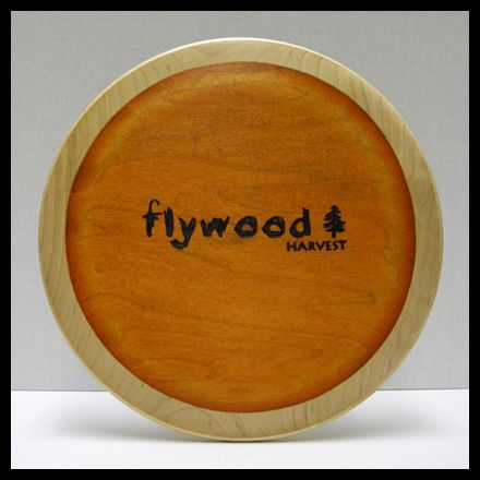 The Flywood Harvest Midrange Wood Disc Golf Disc