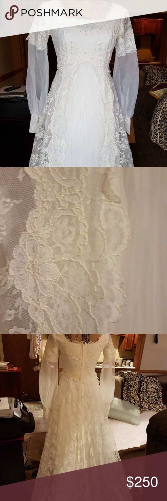Vintage Lace Wedding Dress Circa 1970's.  EUC White Rose Lace Overlay Pleated front Tafetta and Tulle layers. Bodice has Rose Lace with seed white beading.  Sheer long sleeves with 3inch snap closure cuffs This has a 80inch Lace Train and front reaches 47.5 inches to end of pleats. All measured from bodice/waist. Size 6 to 8 Tall now. Has been Cleaned and Stored properly.  This Snowwhite Dress elicits a soft romantic note of chastity.  The Lace denotes Vintage.  Exquisite gown!!  I had to…