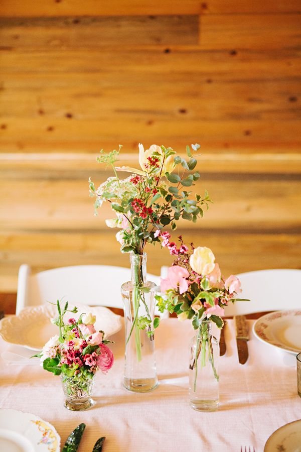 bud vases of varying heights // photo by Tess Pace // http://ruffledblog.com/glam-romance-colorado-wedding