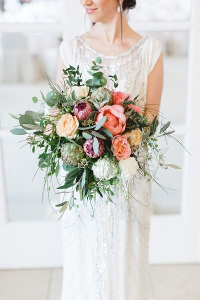 Beautiful bouquet full of greenery and special flowers: http://www.stylemepretty.com/destination-weddings/2014/09/30/germany-wedding-inspiration-clean-classic-elegant/ | Photography: Kibogo Photography - http://www.kibogophotography.com/