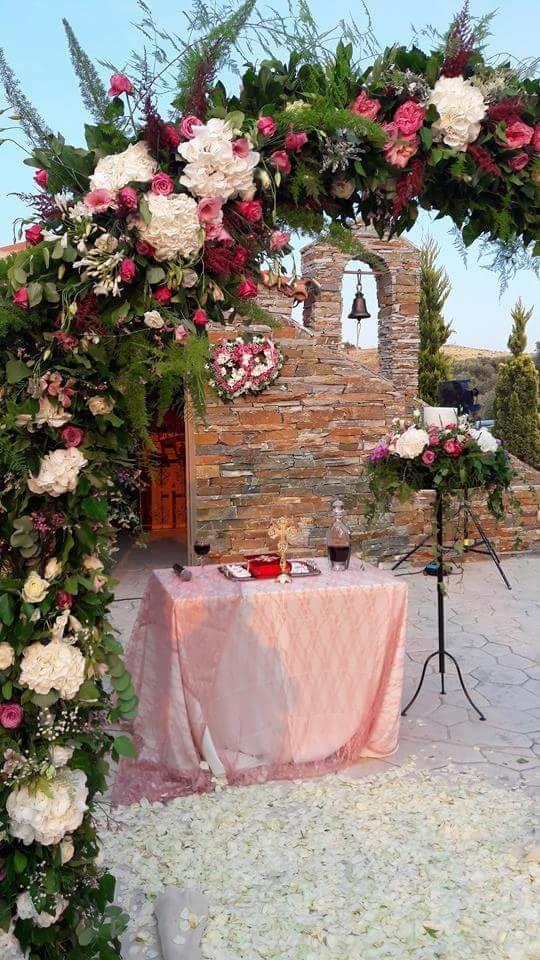 beautiful greek chapel of the greek wedding. Flower arch. Cleopatra's Weddings -  wedding planner in Greece