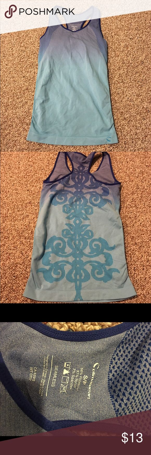 Climawear work out top This is a like new climawear women's work out top. It is a size small and has a built in bra with padding with a super cute design on the back! Also selling on merc! climawear Tops Tank Tops