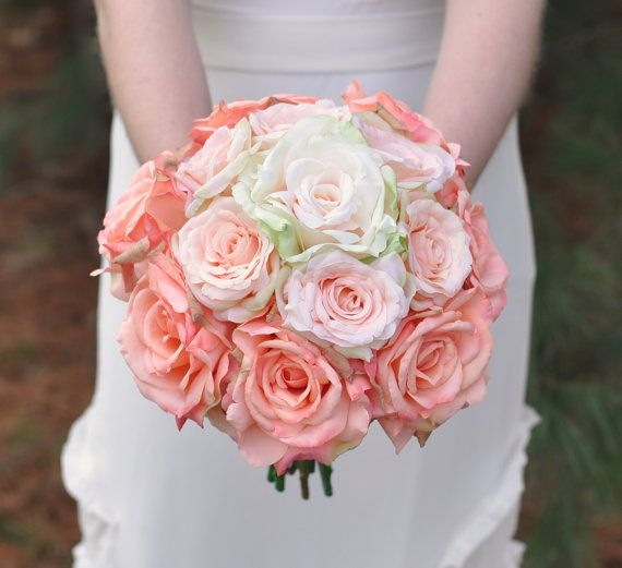 This ombré bouquet is made with varying shades of peach roses that are silk flowers, wrapped with satin ribbon on the stems. This bouquet